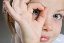 How can parents help in vision development of their child?